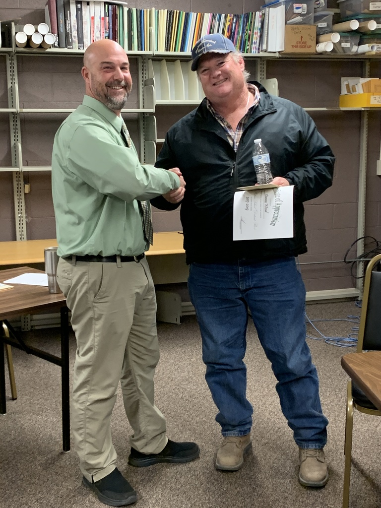 Mr. Seger shaking Danny Wood's hand presenting certificate of appreciation.