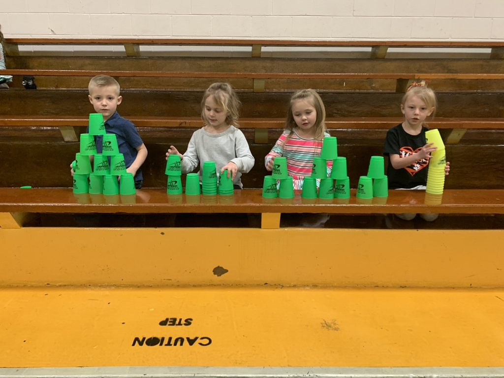 Kindergarteners refining their cup stacking skills.