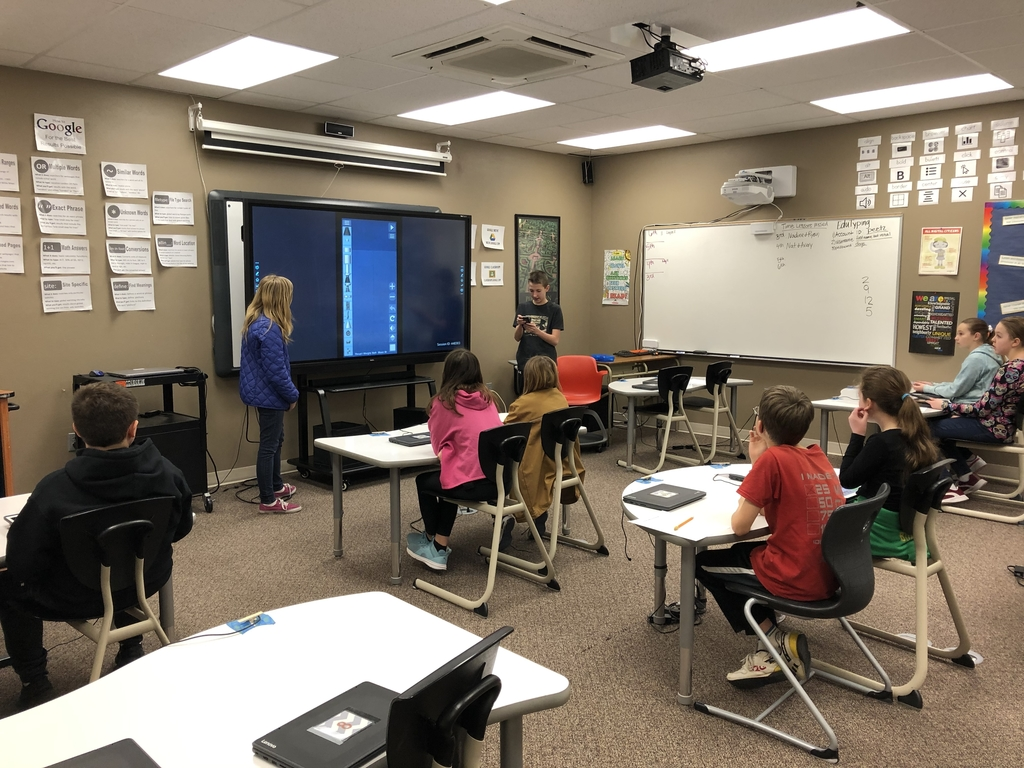 4th students learning from Jr. High students