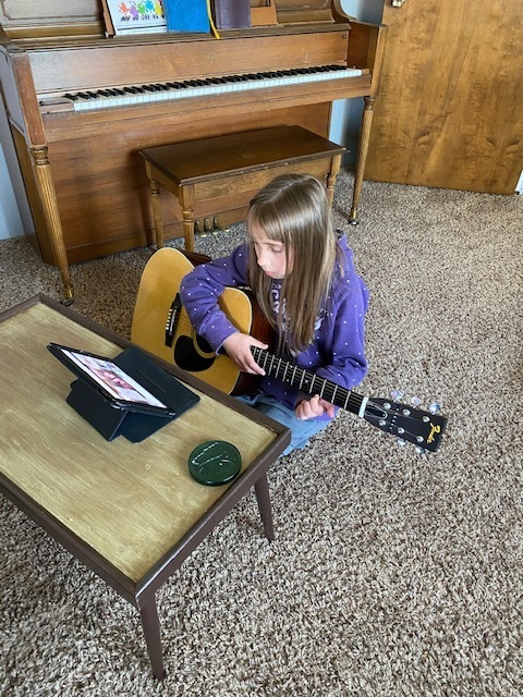 Joy has also been able to work on her guitar skills.