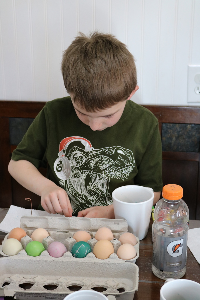 Jared doing his school work and coloring Easter eggs