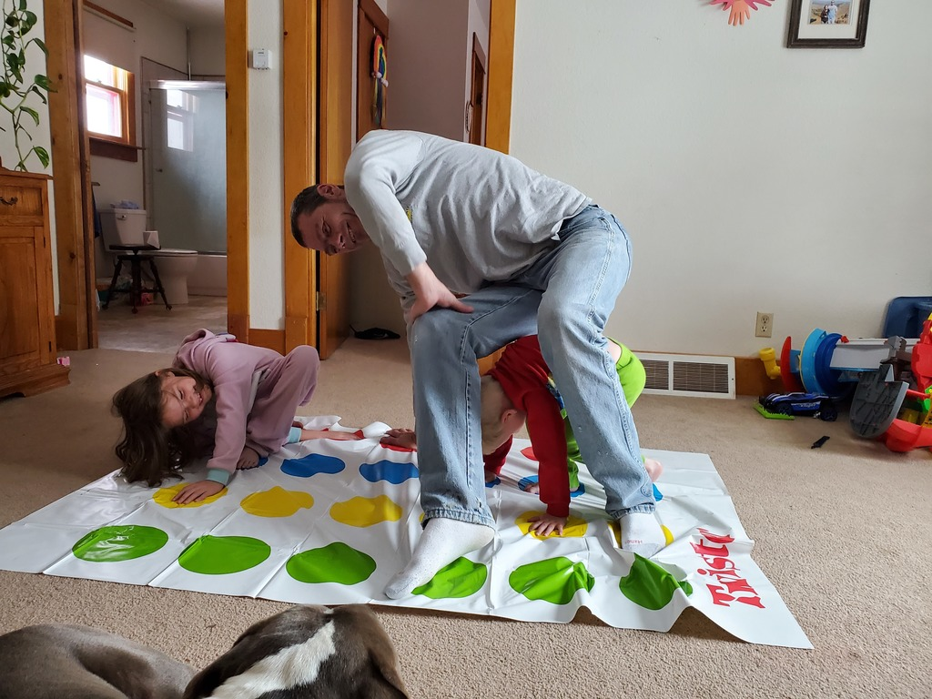kids and dad playing twister