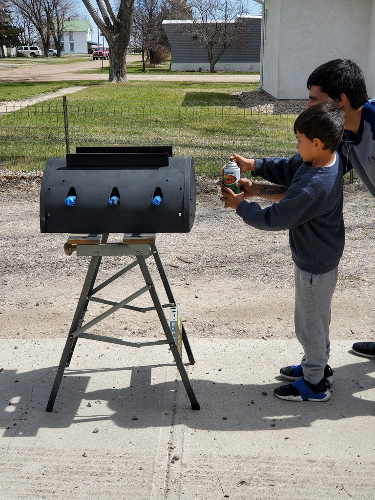Xavier and dad working on grill